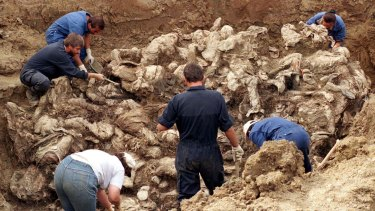 International experts examine bodies believed to be some of the 8000 missing persons who fled Srebrenica in July 1995.