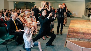 Split focus: Aisles bristling with smartphones can detract from the ceremony.