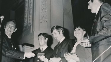 Prime Minister John Gorton presents the singing group The Seekers with plaques to commemorate their being named Australians of the Year in 1968.