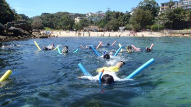 Snorkelling with a bit of assistance at Shelly Beach.