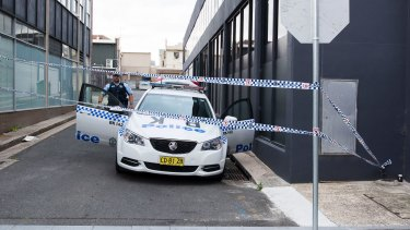 Police guard the laneway where the two boys were arrested in October.