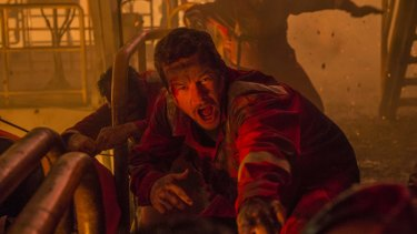 Mark Wahlberg (centre) during the filming of real-life oil rig disaster movie <i>Deepwater Horizon</i>.