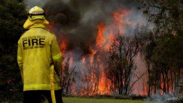 Fire crews battle a blaze at Kurri Kurri on Tuesday.