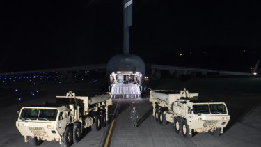 Trucks carrying parts of the American Terminal High-Altitude Area Defence system arrive at Osan air base in Pyeongtaek, South Korea, last month.