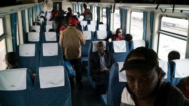 Passengers board the Nairobi-Mombasa train at the new Standard Gauge Railway terminal in Nairobi.