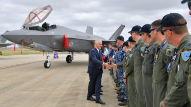 Welcome aboard: Prime Minister Malcolm Turnbull shakes hands with Defence Force members at the first outing of Australia's newest warplane, the F-35 Joint Strike Fighter