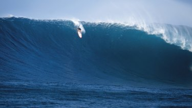 Local legend and big-wave specialist Makua Rothman rides a Jaws monster estimated at 15-plus metres in 2012.