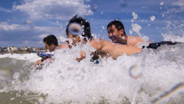Swimmers cool off at Bondi on Tuesday afternoon, as temperatures remained at 30 degrees in parts of the city.