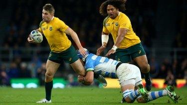 Breakaway: Drew Mitchell's late run sealed the game for Australia.