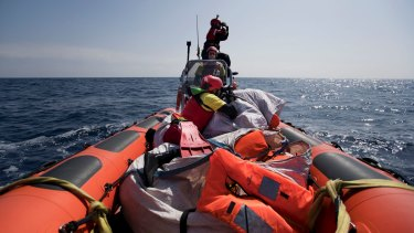 Proactiva Open Arms crew conduct a search and rescue operation in the Mediterranean sea, 12 nautic miles from the Libyan coast, Thursday, April 13, 2017.