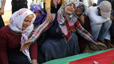 Relatives of a bomb victim mourn in Suruc.