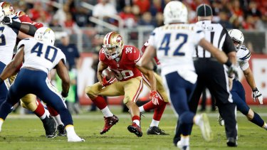Jarryd Hayne #38 of the San Francisco 49ers runs with the ball against the San Diego Chargers during their NFL preseason game in Santa Clara, California.