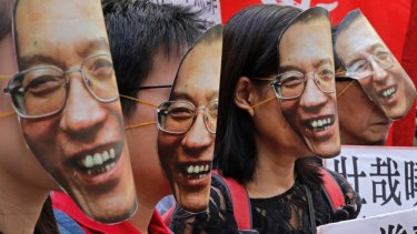 Protesters wear masks of Chinese Nobel Peace laureate Liu Xiaobo during a demonstration demanding his release outside the Chinese liaison office in Hong Kong in June 2017.