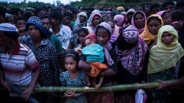 Rohingya Muslims recently arrived from Myanmar queue for food at a refugee camp in Cox's Bazar, Bangladesh, as Aung Sun Suu Kyi made her speech on Tuesday.