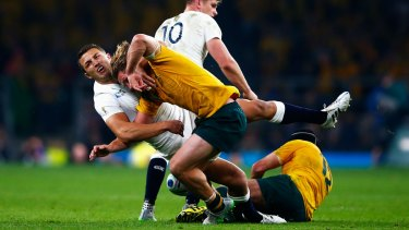 Sam Burgess catches Michael Hooper in the World Cup pool game.