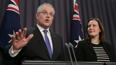 Treasurer Scott Morrison and Minister for Revenue and Financial Services Kelly O'Dwyer address the media during a press conference at Parliament House on Thursday.