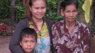 "Eleven-year-old Satunom ""Nom"" Apipat, left, with his mother Salakjit ""Ying"" Apipat (centre) and grandmother Phey Sihawong. Ying says she gave birth to Nom after being raped by rogue monk Wirapol Sukphol."
