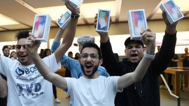 Mazen Kourouche, centre, was among the first to get the iPhone X at the Apple Store in Sydney in November.