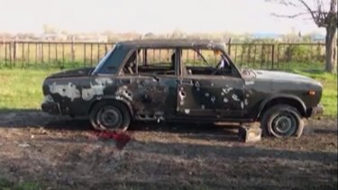 Blood can be seen next to this destroyed car after heavy fighting erupted in Terter, Azerbaijan.
