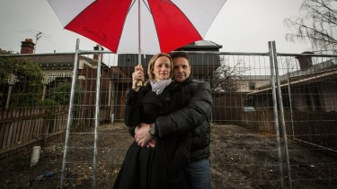 Alison and Mark Attard outside their fenced off Clifton Hill home  in Melbourne.