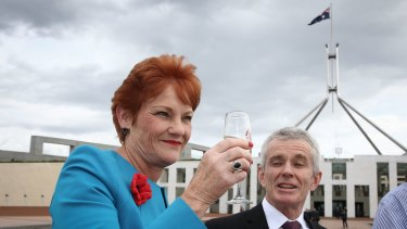 Senators Pauline Hanson and Malcolm Roberts celebrate Donald Trump's success on Wednesday.