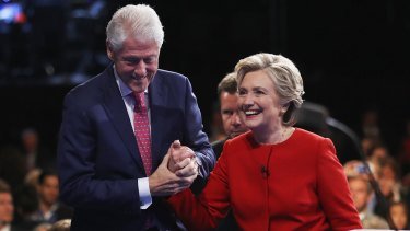 Hillary Clinton shakes hands with husband Bill Clinton after the Presidential Debate with Republican presidential nominee Donald Trump at Hofstra University on September 26, 2016 in Hempstead, New York.