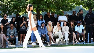 Tyga, Kylie and Kendall Jenner, Kim Kardashian, Carine Roitfeld and Pharrell Williams front row at Yeezy last week.