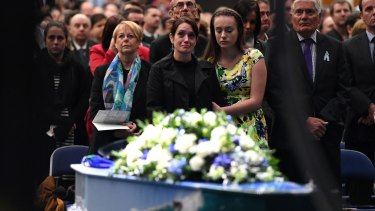 Senior Constable Brett Forte's wife Susan stands next to her daughter Emma during his funeral.