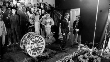 Actress Diana Dors, John Lennon and Ringo Starr on the set of the shoot for the cover of the Beatles Sgt. Peppers Lonely Hearts Club.