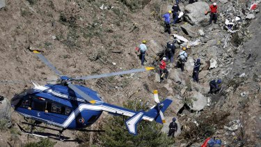 French investigators work through the debris of the crash in the French Alps.