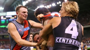 A melee breaks out as Brendon Goddard tries to get teammate Jake Carlisle away from Clinton Jones of the Saints.