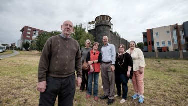 From left to right, opponents to the apartment block proposed to be built behind this guard tower at the former Pentridge prison: Michael Hamel-Green, Coucillor Sue Bolton, Olga Kimpton, Labor MP Kelvin Thomson, Felicity Watson (from the National Trust) and Luise Zanthyr.