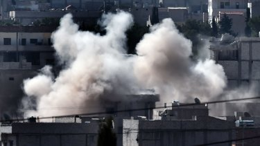 BATTLEFIELD: Smoke rises from Kobane as militants push to take the town.