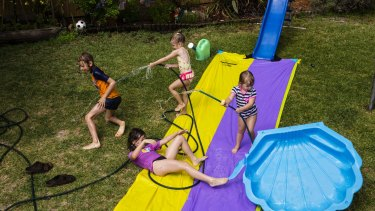 Slides, pools and a hose: more than enough entertainment for a summers day.