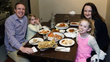 David Feeney, wife Lesley Healy and their girls Elsa and Maeve, at La Disfida restaurant in Haberfield, are part of the trend towards dining out early.