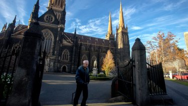 A parishioner at St Patrick's Cathedral on Sunday morning.