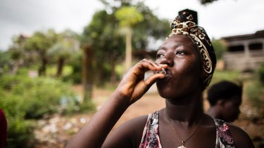 Rebecca Gborie receives an oral cholera vaccination.