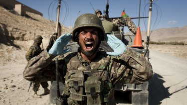 Afghan soldiers carry out a controlled detonation of a roadside bomb in Wardak province.
