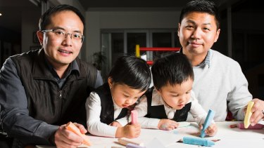 Chan Feng Lin-Wu and Travis Lin-Wu with their two and a half year old twins Jonathan (left) and Jeremy (right).