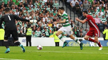Cool: Rogic outpaces the Aberdeen defence before slotting home the matchwinner.
