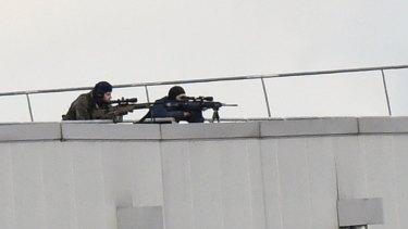 Police marksmen take up position on a roof in Dammartin-en-Goele.