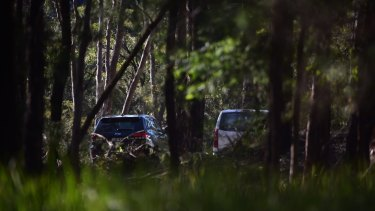 Police at the scene in Kurrajong where two people were found dead on Monday morning.