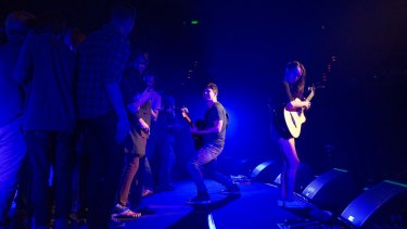 Rodrigo and Gabriela perform with a crowd on stage.