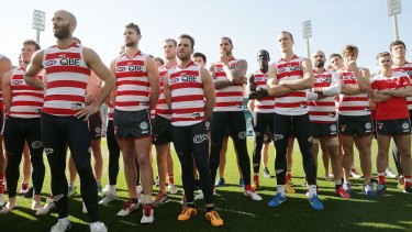 Sydney players stand in solidarity for teammate Adam Goodes.