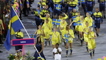 Therese Alshammar carries the flag of Sweden during the opening ceremony for the 2016 Summer Olympics in Rio de Janeiro, Brazil, Friday, Aug. 5, 2016.