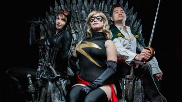 Cosplayers Black Cat, Ardella and Chewie Chan sit on the Iron Throne ahead of Free Comic Book Day.