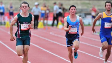 Jack Hale (left) during the first round of the 100 metres sprint at the Australian All Schools Championships at the South Australia Athletics Stadium on Saturday.