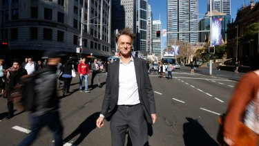 Light rail designer Thomas Richez stands at the intersection of George and Park streets in Sydney.