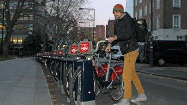 A man takes a Santander bike in London on Monday.
