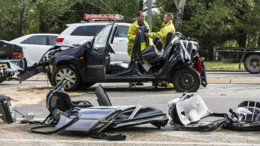 A woman was cut out of a car after the crash on Canberra Ave.